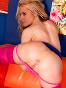 Slim body shalina in sexiest black nylons spreads on the coach. she wears no panties.
