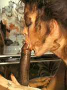 Hairy seventies lady receives a load of cum on her face