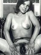 Hairy seventies lady pleasing two cocks with her bumhole
